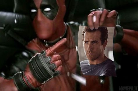 ryan-reynolds-talks-the-deadpool-movie-deadpool-holds-up-a-picture-of-ryan-reynolds-323140.jpg
